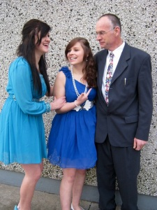 Our eldest daughter Rachel left and Leah middle with their daddy, December 2012.