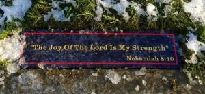 """This is the """"Kneeling Plate"""" on Leah's grave with one of her favourite Bible verses."""