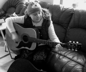 Leah playing guitar1Dec17